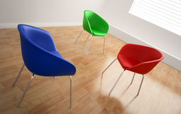 Three chairs in an empty room Royalty Free Stock Images