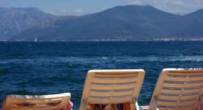 Three chairs at the ocean Royalty Free Stock Photography