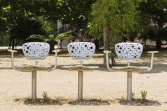 Three chairs in a park Stock Image