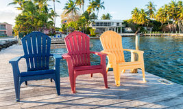 Three chairs with sunset view of the ocean Stock Photography