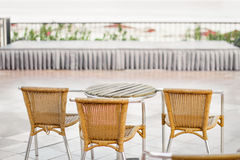 Three chairs and a table Stock Photography