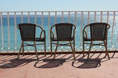 Three chairs in terace above colorful adriatic sea. Three chairs in terace above adriatic sea with great view on the islands in the distance.  This is ideal royalty free stock photos