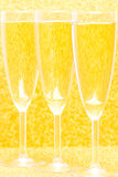 Three Champagne for celebration. Three Champagne Flutes for celebration with golden background Stock Image