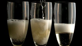 Three champagne flutes stock video footage