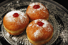 Three chanukkah donuts. Traditional Jewish food for Chanukkah holyday. Luxurious looking sufganiyot stock images