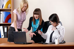 Three charming females at office Royalty Free Stock Photography
