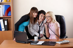 Three charming females at office Stock Images