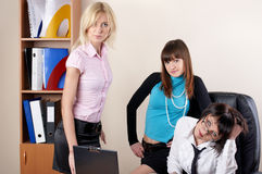Three charming females at office Royalty Free Stock Photo