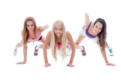 Three charming young sporty girls posing at camera Stock Images