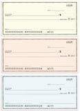 Three checks with no name and false numbers Stock Image