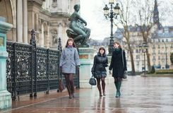 Three cheerful girls walking in Paris Stock Photos