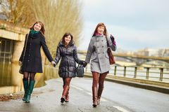 Three cheerful girls walking together in Paris Royalty Free Stock Images