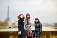 Three cheerful girls walking together in Paris Stock Photos