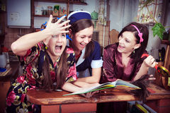 Three cheerful housewives. Portrait of three cheerful housewives Stock Image