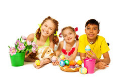 Three cheerful kids together with Eastern eggs Royalty Free Stock Photos