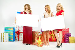 Three cheerful ladies with billboards Royalty Free Stock Photography
