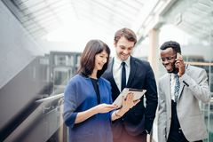 Business people using digital tablet on meeting Royalty Free Stock Photos