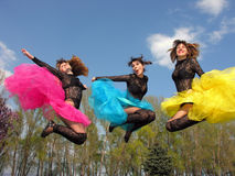 Three cheerful showgirls outdoors Stock Images