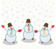 Three cheerful snowmen Stock Photography