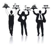 Three cheerful waiter Stock Photography