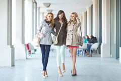 Three cheerful woman walking in the first day of spring Royalty Free Stock Images