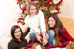 Three cheerful women having fun on Christmas Royalty Free Stock Photo