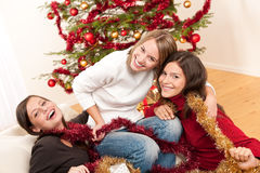 Three cheerful women having fun on Christmas Stock Images