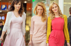 Three cheerful women in the shopping mall Royalty Free Stock Image