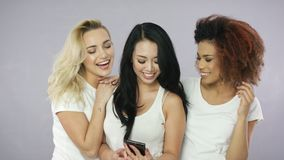 Cheerful women standing with smartphone stock video footage