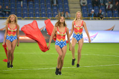 Three cheerleaders dancing on the field Stock Photos