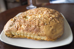 Three cheese foccacia bread. On white plate Royalty Free Stock Images