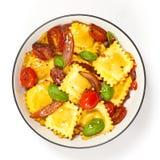 Three cheese ravioli with tomato Royalty Free Stock Photos