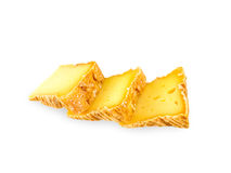 Three cheese slices. Three soft washed-rind cheese slices isolated on white Royalty Free Stock Photo