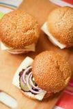 Three cheeseburgers Stock Photography