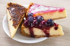 Three cheesecake slices Royalty Free Stock Photos