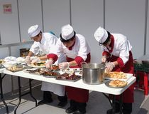 Three Chefs at a Cooking Competition Royalty Free Stock Photo
