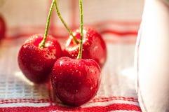Three cherries closeup Stock Photos