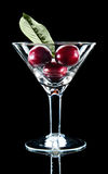 Three cherry and leaf in wine glass Stock Image