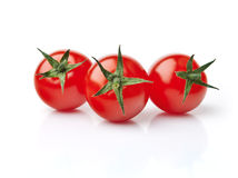 Three Cherry Tomatoes. Close up of three fresh red cherry tomatoes Stock Photography