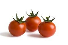 Three cherry tomatoes  Royalty Free Stock Photos