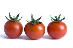 Three cherry tomatoes  Stock Photos
