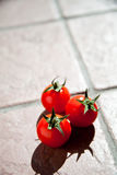 Three cherry tomatoes Royalty Free Stock Image
