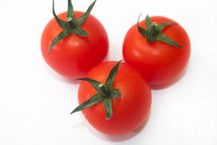 Three cherry tomatoes on the white background Royalty Free Stock Images