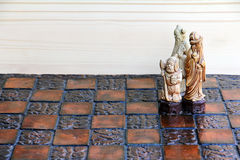 Three chess pieces on a chessboard Stock Photography