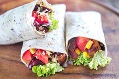 Three chicken burritos royalty free stock photography