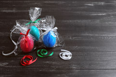 three chicken easter eggs in festive packaging with ribbons Royalty Free Stock Images