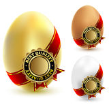 Three chicken eggs Stock Images