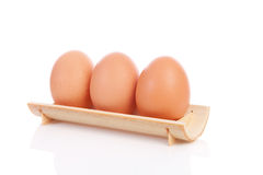 Three chicken eggs in a row Royalty Free Stock Photography