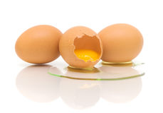 Three chicken eggs on white background Stock Images