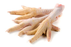 Three chicken feet  on white background Stock Photos